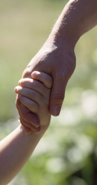 dad and child holding hands